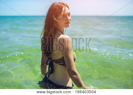 Happy Wet Young Woman Standing Back In Blue Sea