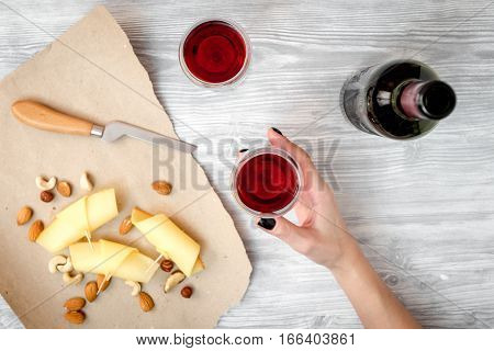 red wine with cheese on wooden background top view.