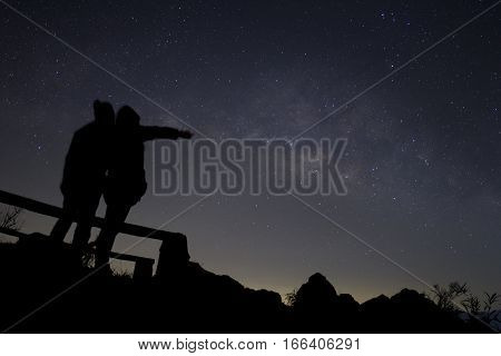 Couple in love silhouette and the Milky way love and valentines concept long exposure astronomical photograph