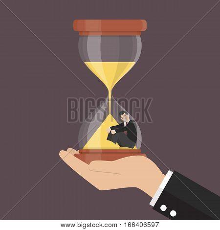 Small businessman stuck in sandglass. Business concept