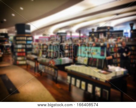 Vintage style color tone.Blur image of a bookstore