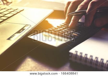 Closeup Of Hand Female Using Calculator And Calculate About Cost At Home Office.