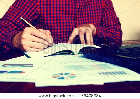 Businessman Writing Make Notes With Calculate About Cost At Home Office.