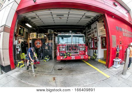 New York, September 26, 2016: Ladder 35 fire truck is parked in the fire station in Manhattan.
