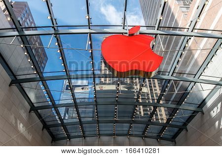 New York, December 3, 2016: Big Apple logo inside the Apple Store on Broadway and West 67th street is illuminated red.