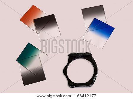 Graduated Neutral density camera filters with holder used for photography isolated.