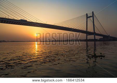 Vidyasagar Setu the longest cable bridge in India at sunset. Photograph taken from a boat near Princep ghat, Kolkata.