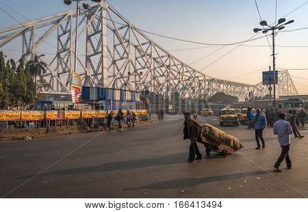 KOLKATA, INDIA, DECEMBER 08, 2016: City road traffic near Howrah bridge on a foggy morning. Photograph taken on the road close to Howrah Railway Station, Kolkata.