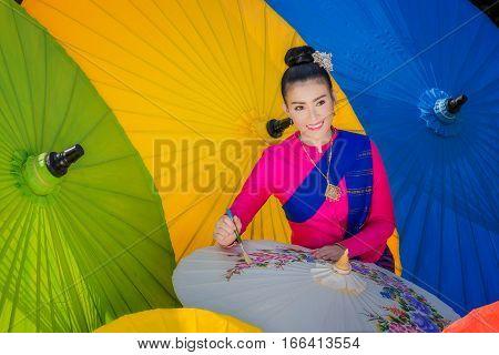 Portrait Of Beautiful Thai Women In Lanna Traditional Costume,  Handmade Umbrella Making Vintage Sty