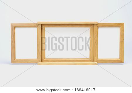 Three woodens picture frames on white background. Two size wooden picture frames.