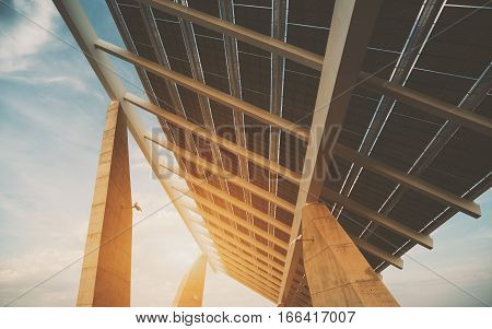 Close-up view of modern solar photovoltaic panel huge solar battery in Forum district zone Barcelona Spain wide angle shoot from bottom on sunny day