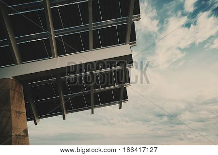 Close-up fragment of modern hi-tech solar photovoltaic panel with empty space for your message on the right huge solar battery in Forum district zone Barcelona Spain view from bottom