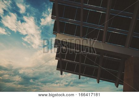 Close-up fragment of modern hi-tech solar photovoltaic panel with empty space for your message on the left on sky huge solar battery in Forum district zone Barcelona Spain view from bottom