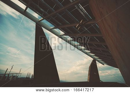 Abstract fragment of modern contemporary hi-tech solar photovoltaic panel huge solar battery giant energy producing structure Barcelona Spain Forum district view from bottom