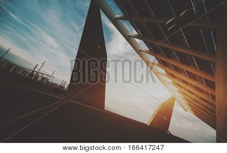 Abstract fragment of modern contemporary hi-tech solar photovoltaic panel huge solar battery giant energy producing structure Barcelona Spain Forum district sunset view from bottom