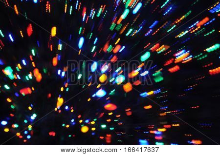 motion blur with zoom effect of Christmas Tree Holiday lights