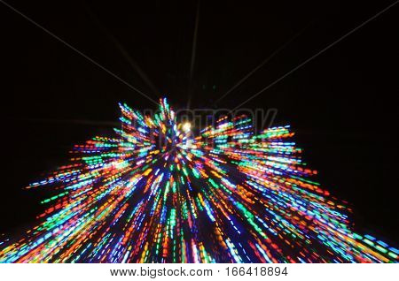 blurred Christmas Tree lights with motion blur and zoom effect