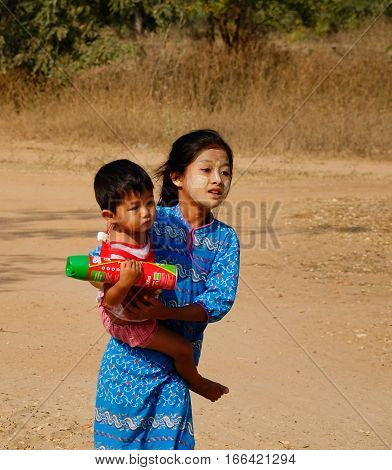 Burmese Children Playing On Rural Road