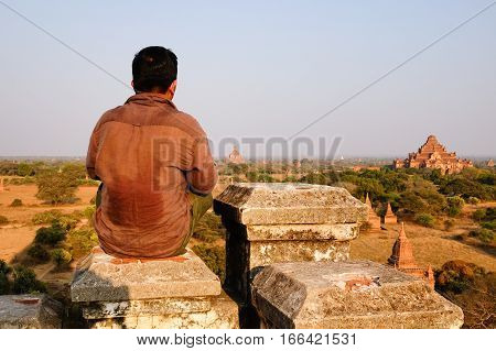 Tourist Sitting And Looking The Bagan Temples