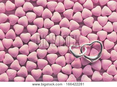 valentine's day congratulation card a bunch of little pink candy scattered silver pendant two hearts