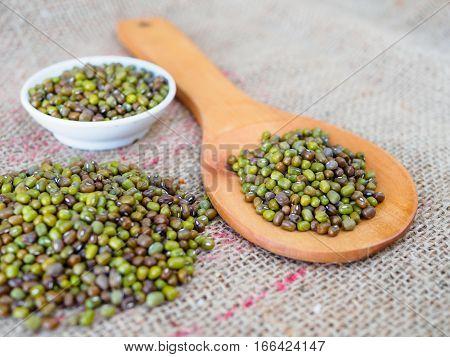 green bean on brown hemp sack texture background