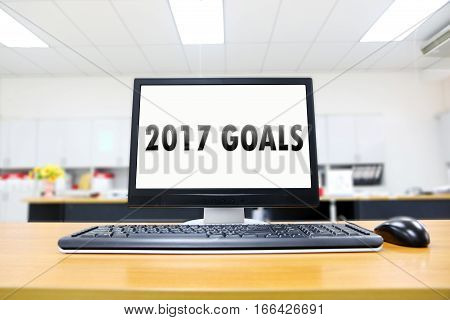 2017 goals list with computer screen in room office.