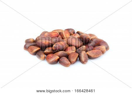 Pine nuts in shell isolated on a white background.