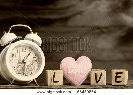 Letters Spelling Love. Pink Heart And Wooden Letters Spelling Love