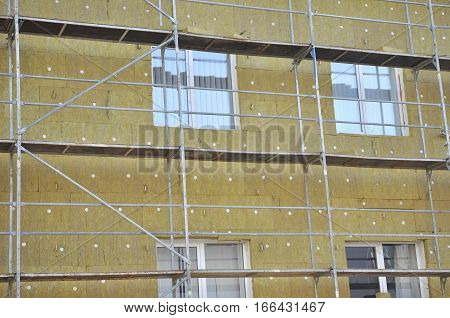 Exterior wall heat isolation with mineral wool in therepai house building under construction
