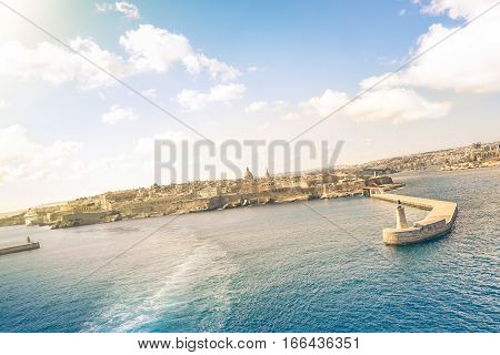 Tilted horizon view of La Valletta before sunset from the sea - Travel and wanderlust concept with capital of world famous mediterranean island of Malta - Wide angle composition with cruise ship track