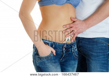 young girl in jeans and a naked stomach and man touching her and paying her the money for the love.