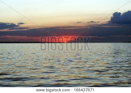 clouds above the horizon during sunset sea
