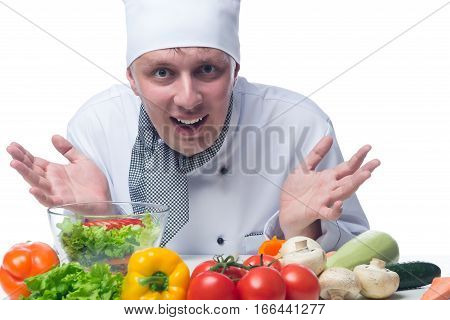 chef showing his hands in front of a vegetable salad