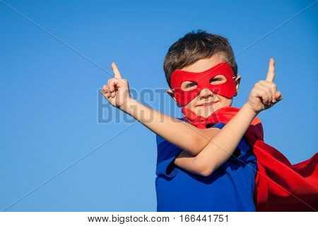 Happy Little Child Playing Superhero.