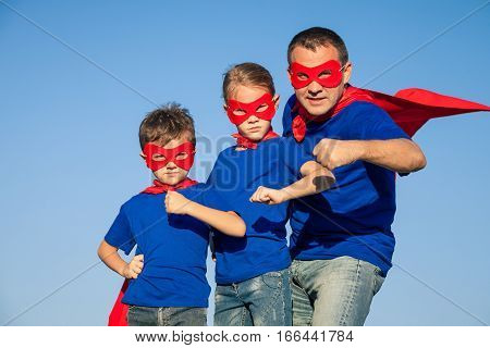 Father And Children Playing Superhero At The Day Time.