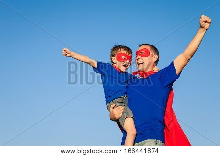 Father And Son Playing Superhero At The Day Time.
