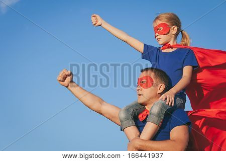 Father And Daughter Playing Superhero At The Day Time.