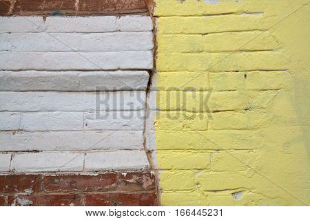 Colorful (yellow white and brown) brick wall as background texture