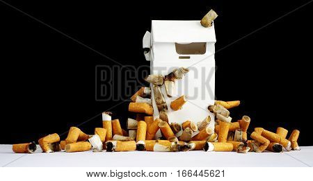 Cigarette butts a box about the health risks.