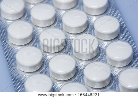 Group of large tablets in packaging closeup shot