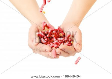 Hands Is Giving Red Capsules And Orange Pills On White Background.