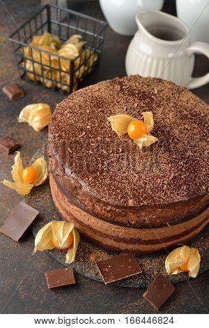 Chocolate cake with Bavarian mousse on brown background