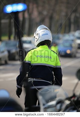 Round Flashing Siren Of Italian Police Motorcycle And A Traffic