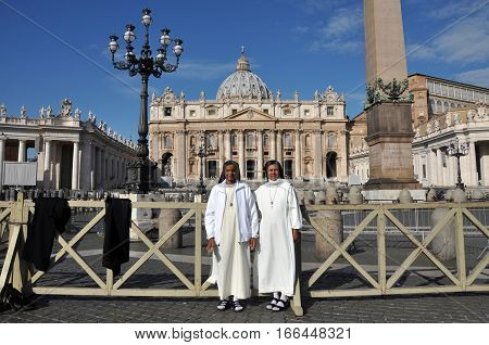 Catholic Nun Posing In The Front Of The Saint Peter Basilica In Vatican