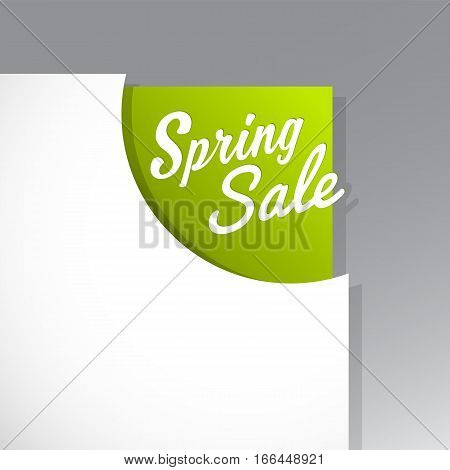 Spring Sale text uncovered from torn paper corner.