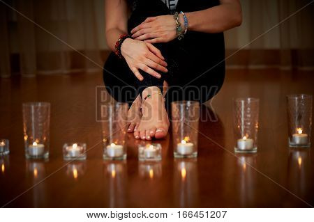 Candles lit, feet Relaxation and yoga in evening