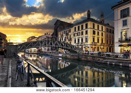 Bridge across the Naviglio Grande canal at the evening in Milan Italy