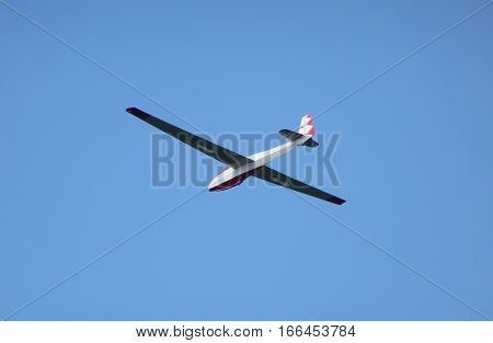 Photo of a glider flying through air