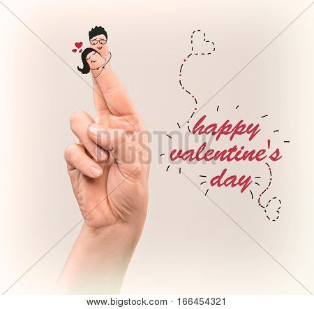 A happy couple in love with painted smiles on fingers. The happy Valentine's Day concept