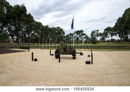 JOONDALUP, WA/AUSTRALIA - MARCH 2016: Gun in front of ANZAC war memorial in Joondalup Central Park Perth Western Australia